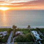 aerial photo of 325 Gulfshore Blvd Naples, FLorida at sunset with view of Gulf of Mexico